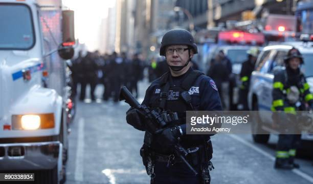 A heavily armed New York Police Department Strategic Response Group officer stands guard at the scene after an explosion occured at the Port...