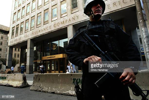 A heavily armed Newark Police officer stands guard outside the Prudential Insurance Company building August 10 2004 in Newark New Jersey Security has...