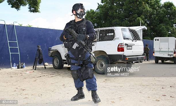 Heavily armed police and soldiers guard the Magistrates Court as opposition Member of Parliament Charles Dausabea appears in court under heavy...