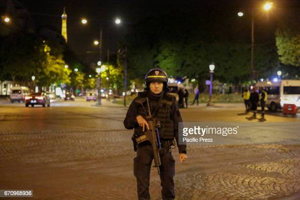 A heavily armed police officer is pictured at ChampsElysees The ChampsElysées avenue in Paris has been closed off by Police after an terror attack...