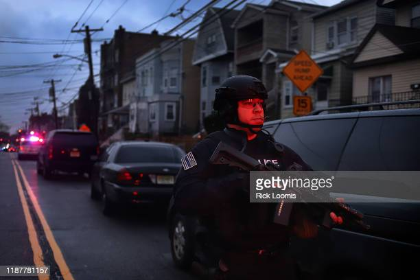 Heavily armed police officer is shown on the scene of a shooting that left multiple people dead on December 10, 2019 in Jersey City, New Jersey. In a...