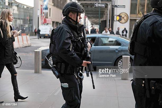 Heavily armed police patrol the streets in lower Manhattan following a heightened terror alert after attacks in the Belgian capital of Brussels on...