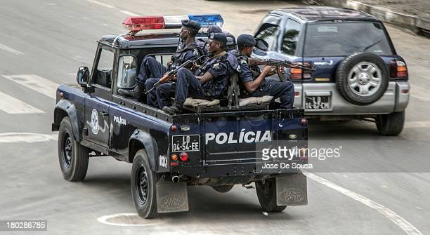 CONTENT] A heavily armed Police squad patrol keeping law and order in the city of Luanda Angola
