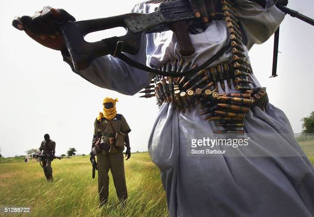 Heavily armed rebel Sudanese Justice and Equality Movement fighters patrol looking for Janjaweed militiamen near their base in the Darfur region of...