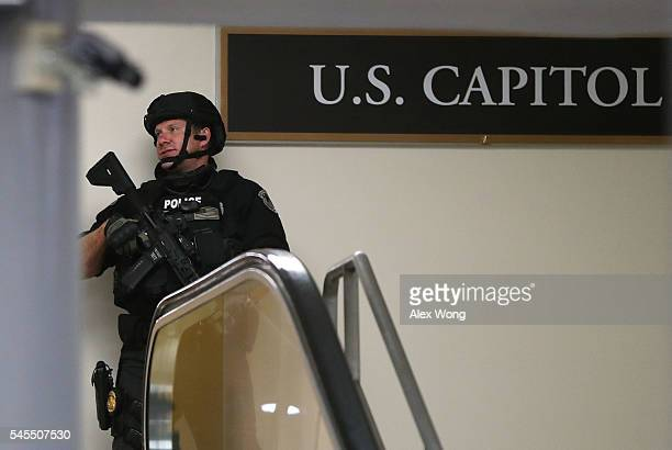 A heavily armed US Capitol Police officer stands guard a hallway at the basement of the Capitol during a lockdown July 8 2016 in Washington DC The...