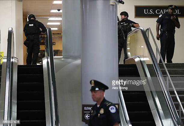 Heavily armed US Capitol Police officers stand guard a hallway at the basement of the Capitol during a lockdown July 8 2016 in Washington DC The...