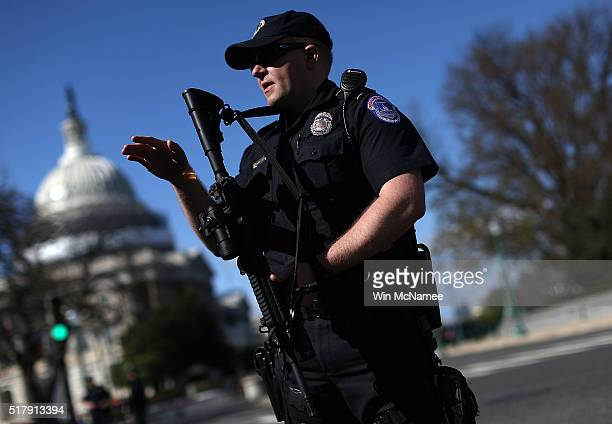 Heavily armed US Capitol police stand guard outside the US Capitol after at least one person was shot in the Capitol Visitor Center March 28 2016 in...