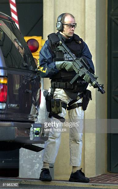 A heavily armed US marshal stands guard at the entrance of the courthouse where FBI spy Robert Hanssen is expected to plead guilty to charges that he...
