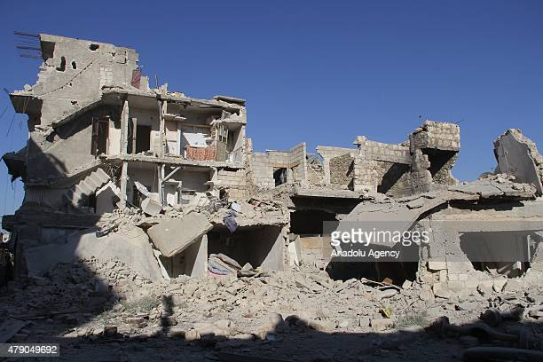 A heavily damaged building is seen after Asad Regime Forces' barrel bomb attack on the residential areas in Bab alNairab neighborhood of Aleppo Syria...