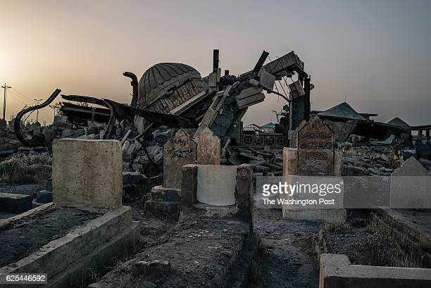 Heavily damaged graves and shrines at the Tikrit cemetery