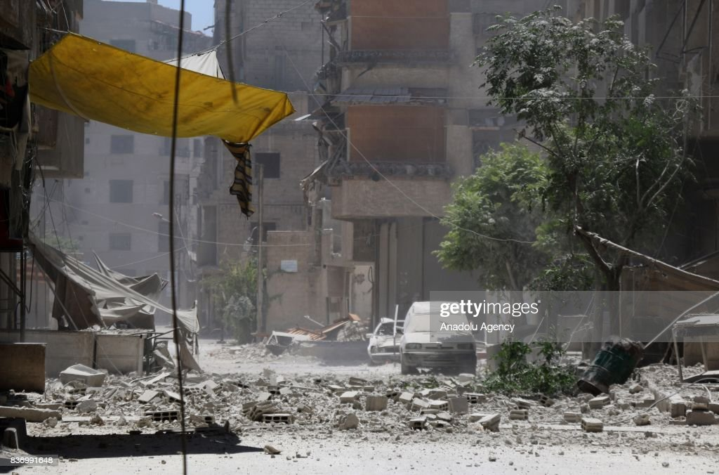 A heavily damaged street with buildings is seen after Assad Regime's forces strike over the de-conflict zone, Ein Tarma Town of Eastern Ghouta region of Damascus, Syria on August 22, 2017.