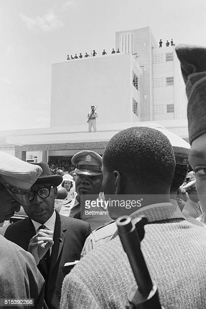 Heavily Guarded PortAuPrince Haiti Heavilyarmed soldiers May 12 surround Haitian President Francois Duvalier as he makes his first public appearance...