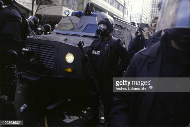 A heavily militarized police force confronts environmental activists trying to shut down the streets of downtown Seattle to disrupt a meeting of the...