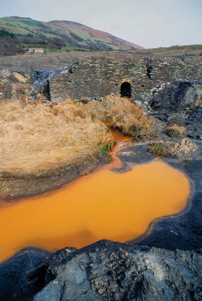 Heavily polluted water and mining spoil at site of former lead mine.