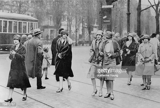 Heavily retouch photograph shows a number of women as they walk across tram tracks on the Kurfurstendamm Berlin Germany 1926