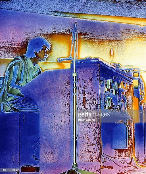 Heavily solarised image of Steve Winwood of Traffic performing with their psychedelic lightshow at The Kirklevington Country Club near Middlesbrough...