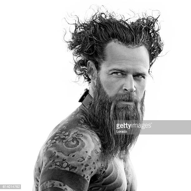 heavily tattooed bare chested handsome male standing in warrior stance - chest barechested bare chested fotografías e imágenes de stock