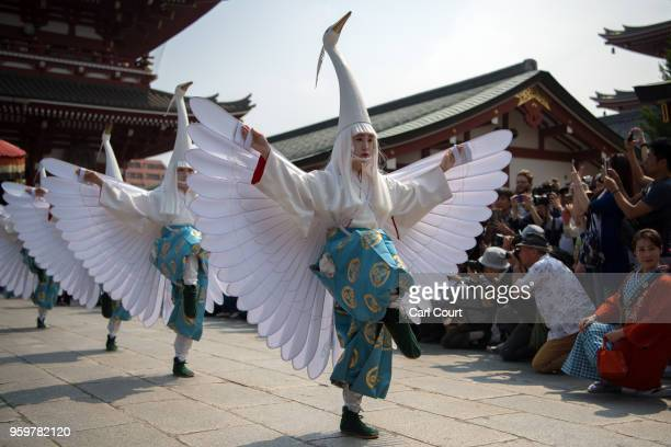 Heavily tattooed Japanese jump from a platform as they participate on the third and final day of Sanja Festival near Asakusa Temple on May 20 2018 in...