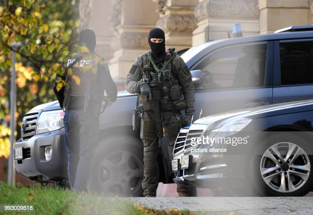Heavily weaponized police officers can be seen in front of the federal court in Karlsruhe, Germany, 1 November 2017. They are containing a terror...