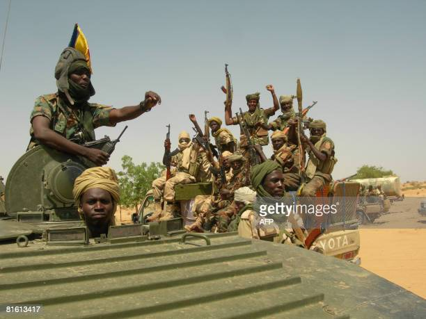 Heavilyarmed Chadian troops celebrate after having routed rebel forces in Am Zoer north east of the capital Abeche on June 18 killing more than 160...
