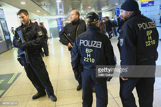 Heavilyarmed German policemen keep a watchful eye as commuters walk by in Hauptbahnhof main railway station the day after the Germany vs Netherlands...