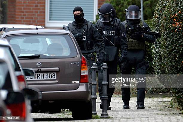 Heavilyarmed members of the German SEK special forces police unit stand outside a house in Schaufenberger Strasse street where they possibly made two...