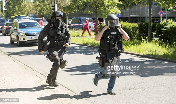 Heavilyarmed police outside a movie theatre complex where an armed man has reportedly opened fire on June 23 2016 in Viernheim Germany According to...