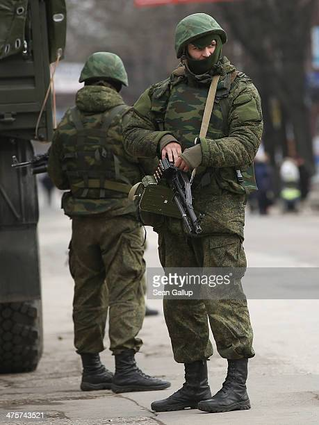 Heavily-armed soldiers displaying no identifying insignia maintain watch in a street in the city center on March 1, 2014 in Simferopol, Ukraine....