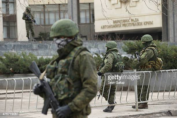 Heavily-armed soldiers without identifying insignia guard the Crimean parliament building shortly after taking up positions there on March 1, 2014 in...