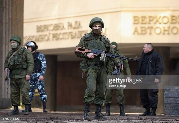 Heavilyarmed soldiers without identifying insignia guard the Crimean parliament building after taking up positions there earlier in the day on March...