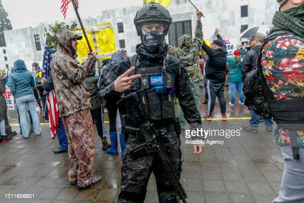 Heavily-armed young man poses for a photo with his assault rifle during the protest at the State Capitol in Salem, Oregon, United States on May 2,...