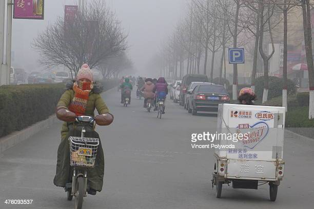 Heavy air pollution gripped Anyang City on Christmas Day, 2013. Commuters in central China have no choice but to brave the hazardous haze.