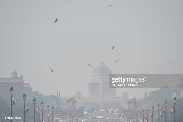 TOPSHOT Heavy air pollution is pictured around Rashtrapati Bhavan and government buildings in New Delhi on October 15 2019 New Delhi banned the use...