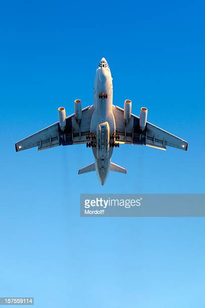 heavy airplane flying in blue sky. slight motion blur - military airplane stock pictures, royalty-free photos & images