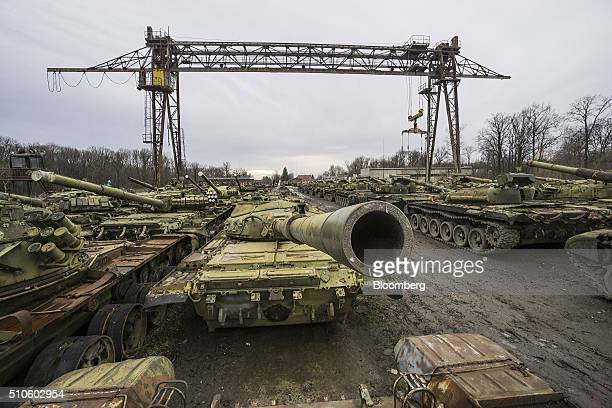 Heavy armor including T72 battle tanks sit in a storage area for broken machinery ahead of repair or recycling at the military workshop operated by...