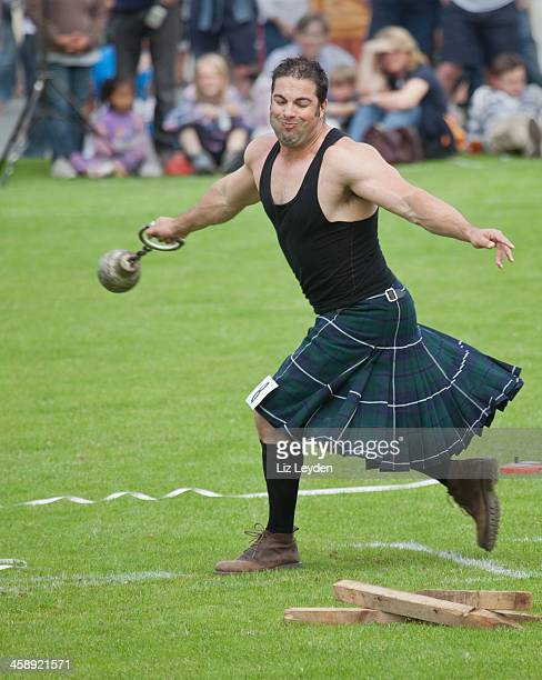 Heavy athlete in 28lb weight contest, Brodick Highland Games, Arran