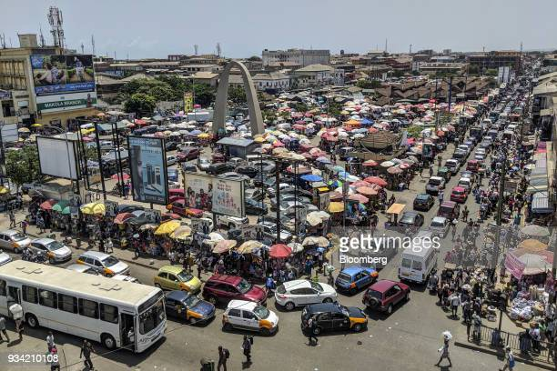 Heavy automobile traffic passes by Makola market in Accra Ghana on Thursday March 15 2018 Ghana wants to shake up the way it collects tax with the...