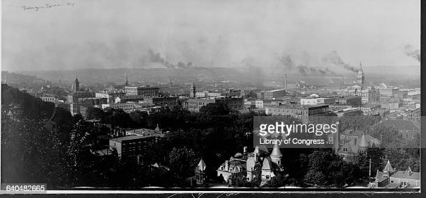 Heavy black smoke pouring from factory chimneys pollutes the skies of Dubuque Iowa