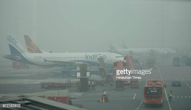 Heavy blanket of smog at Indira Gandhi International Airport terminal 1D on third consecutive day on November 9 2017 in New Delhi India Air pollution...