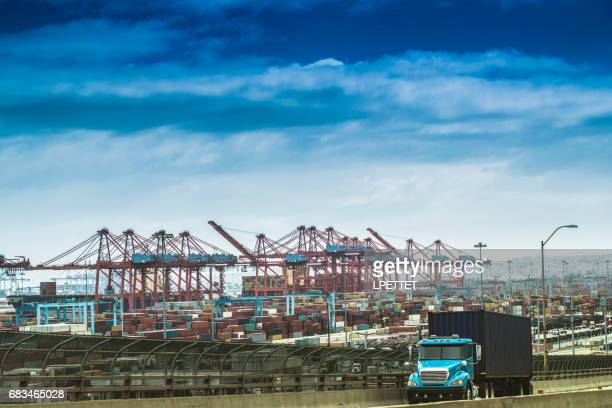 heavy cargo on the road - port of los angeles stock pictures, royalty-free photos & images