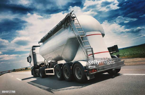 heavy cargo on the road - gas tank stock photos and pictures