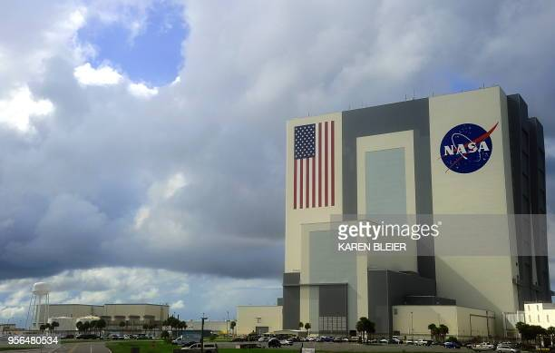 Heavy clouds begin to move over the Vehicle Assembly Building on September 11 2009 at the Kennedy Space Center in Florida NASA waved off two landing...