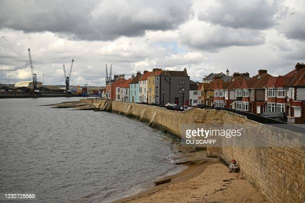 Heavy clouds hang over the Headland area of Hartlepool in north-east England on May 6 on the day that voters cast their ballots in the Parliamentary...