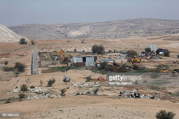 Heavy construction equipments belong to Israel demolish houses at Umm alHiran village in Beersheba Negev on January 18 2017