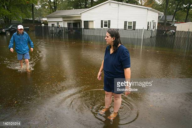 Heavy continuous rain caused a stream that flows from Lake Holbrook to overflow flooding a neighborhood in Holbrook in the Grove section along Fern...