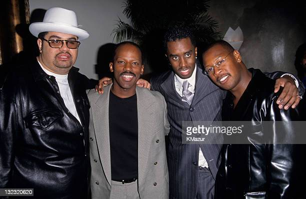 Heavy D Sean Puffy Combs and Andre Harrell attend Justin's Opening on September 30 1997 in New York City
