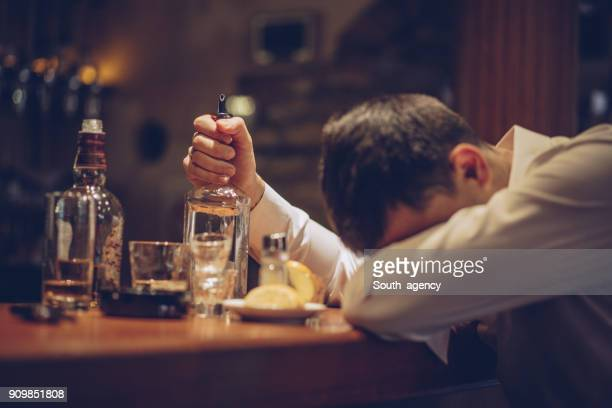 heavy drinking in bar - binge drinking stock photos and pictures