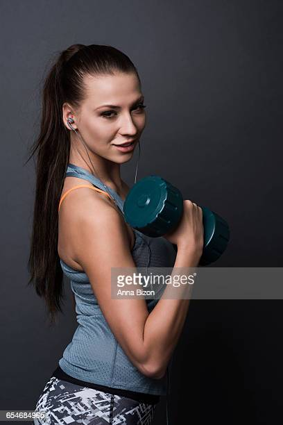 Heavy dumbbell held by a strong woman. Debica, Poland