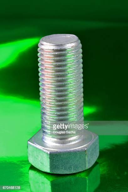 Heavy duty fastening bolt on green background