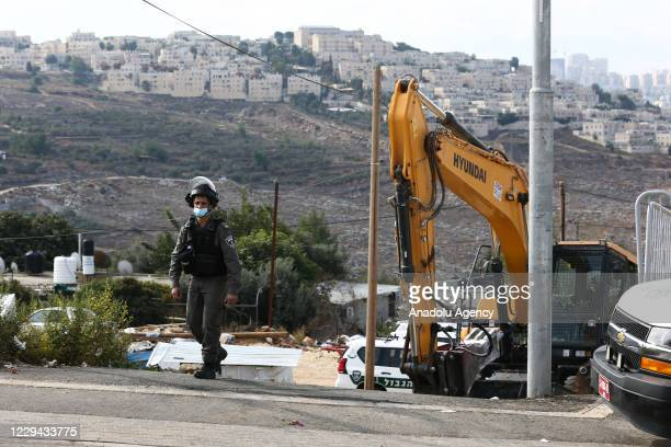 Heavy duty machines of Jerusalem Municipality demolish a house accompanied by Israeli security forces with the order of Israeli authorities claiming...